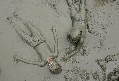 laying in the mud