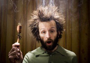 guy electrocuted with spiky smoking hair